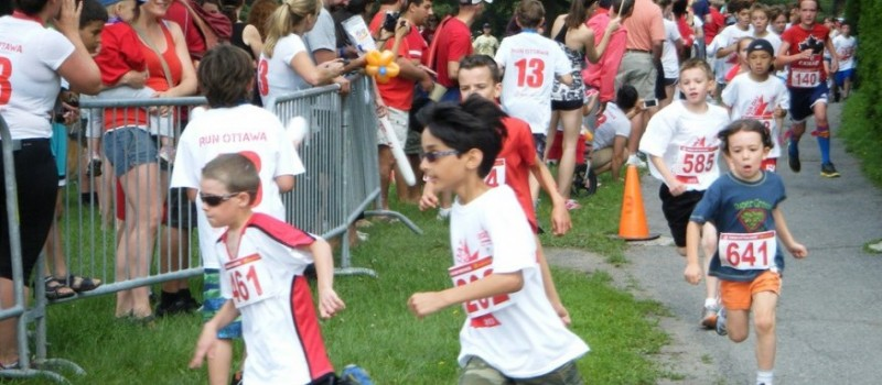 Kids running the 1.5K race at the 2013 Canada Day Road Races