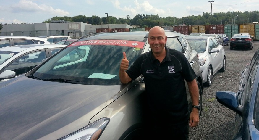 Race Director poses with SUV ready for shipment