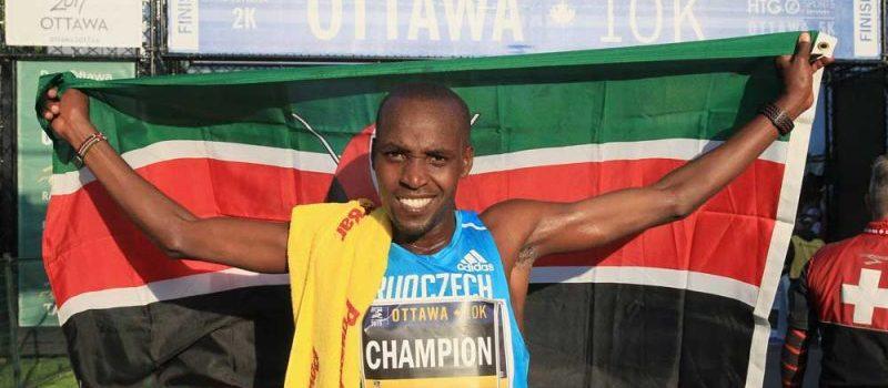 Nicholas Bore raises Kenyan flag at 2015 Tamarack Ottawa Race Weekend