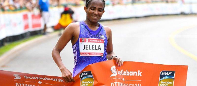 Koren Jelela crosses the 2016 Ottawa Marathon finish line