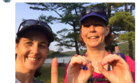 Kristi celebrates running 100K with fellow trail runner Leanne Richardson
