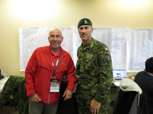 John Halvorsen and Maj. Gerant in front of a map of the Army Run course