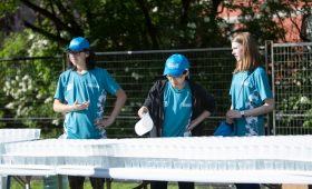 Tamarack Ottawa Race Weekend volunteers serve up water on the course with the help of Aquahaulics