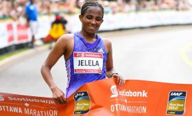 Koren Jelela crosses the 2016 Ottawa Marathon finish line