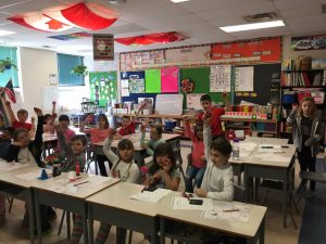 St. Isadores' Kids Run Ottawa Club pose in their classroom