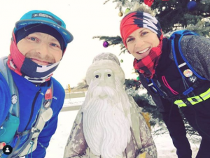 Erika Goreski and Cliff Trafford pose with an unsuspecting Santa while running
