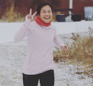 A smiling and laughing Lisa Sun gets takes on another winter run