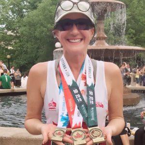 Lorena MacKenzie shows off her Tamarack Ottawa Race Weekend 2019 medals